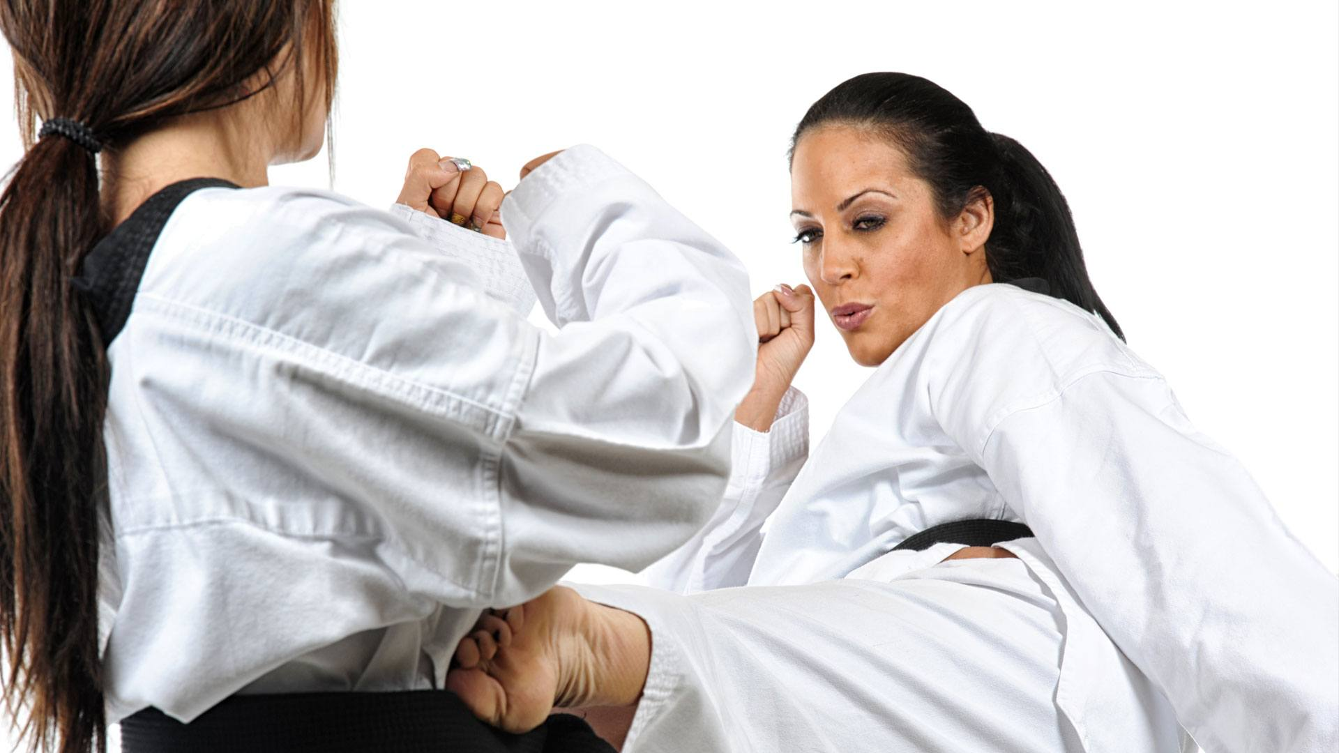woman practicing martial arts moves